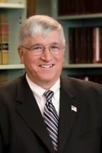Lewis G. Brewer, J.D., LL.M.